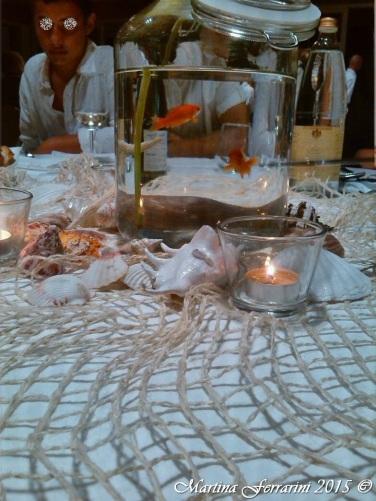 Centro tavola con pesci rossi da adottare